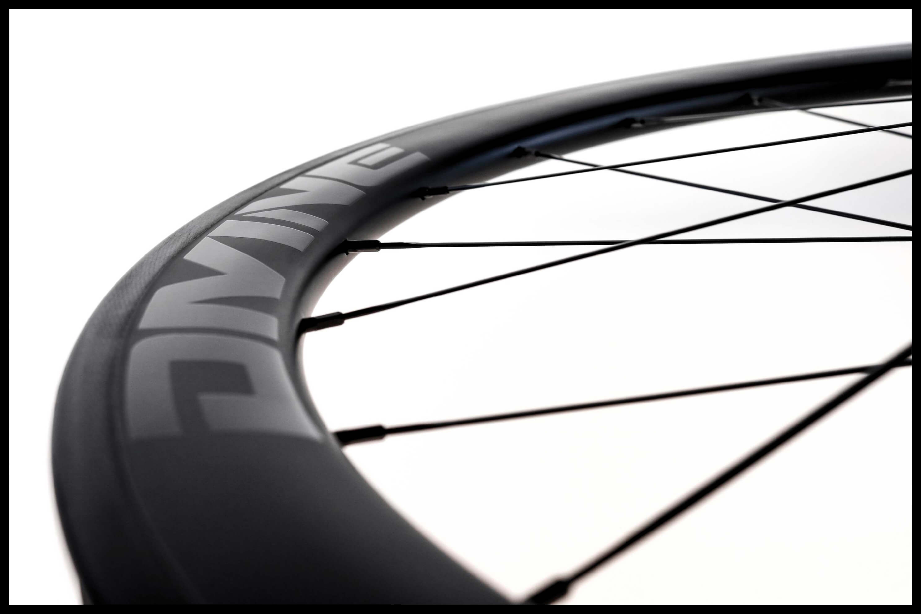 Carbon Road Bike Rim Logo Close-up | Divine Cycling